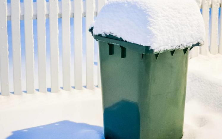 Snow covered trash can